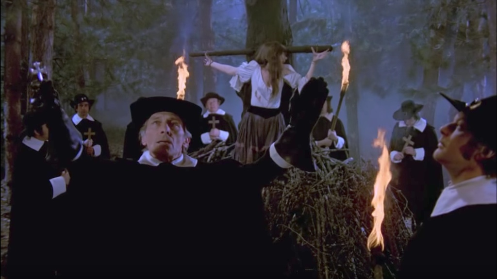 Peter Cushing's Weil prepares to burn another witch as a fellow Brotherhood member (Harvey Hall) looks on.