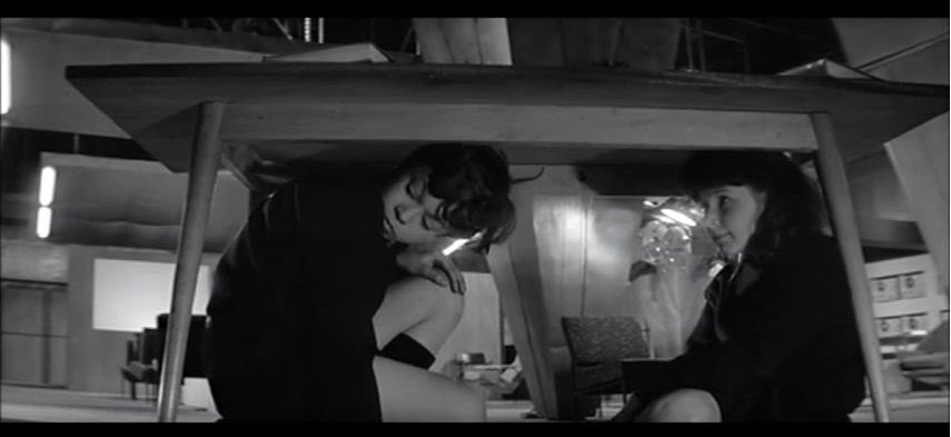 Two of the Children huddle under a table in The Damned (1963).