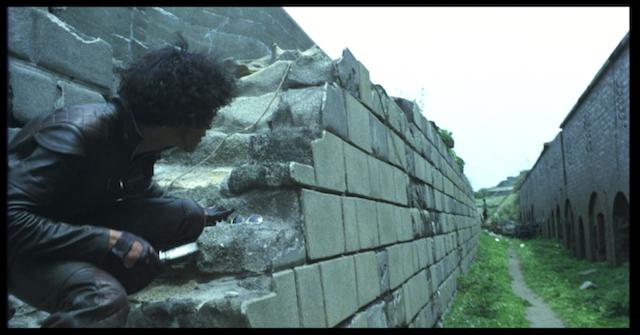 Yusaku Matsuda sneaks up some stairs in Yomigaeru Kinrou