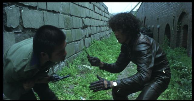 Yusaku Matsuda stabs a guard